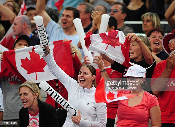 Canadian fans celebrate their team's comeback over the US in their men's wheelchair basketball semifinal during the 2008 Beijinjg Paralympic Games on...