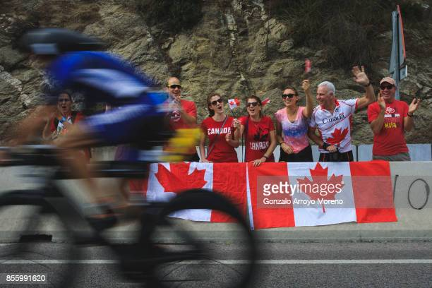 Canadian fans cheer athletes as they compete during the biking course of the IRONMAN Barcelona on September 30 2017 in Barcelona province Spain