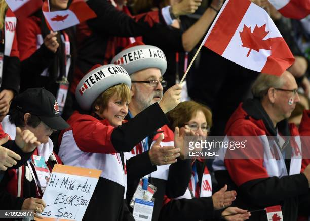 Canadian fans cheer for their team during the Men's Curling Gold Medal Game between Canada and Great Britain at the Ice Cube Curling Center in Sochi...