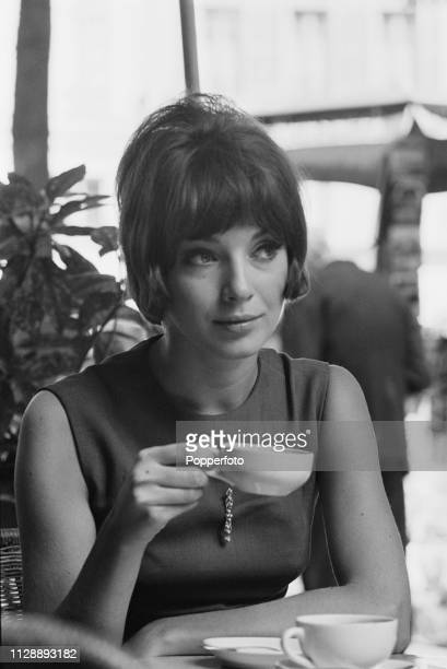 Canadian fashion model and actress Joanna Shimkus pictured drinking a cup of coffee in a cafe in Paris France in August 1963
