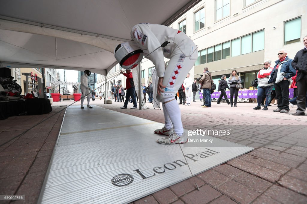 Canadian Fencing Olympian Maxime Brinck-Croteau pretends to be out of breath during an outdoor demonstration on Sparks Street during the Medley on the Street event on April 20, 2017 in Ottawa, Canada. The Medley on the Street event promotes Fencing Week in Canada and the upcoming National Canadian Fencing Championships.