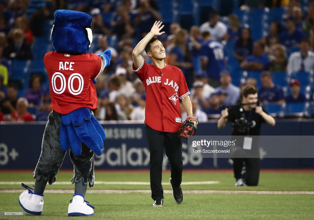 Canadian figure skating champion Patrick Chan acknowledges the crowd before throwing out the first pitch before the start of the Toronto Blue Jays MLB game against the Oakland Athletics at Rogers Centre on July 26, 2017 in Toronto, Canada.