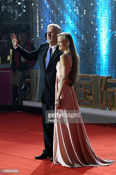Canadian film director James Cameron and his wife Suzy Amis arrive for the red carpet of 2nd Beijing International Film Festival at China National...