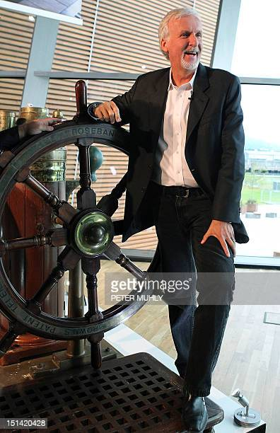 Canadian film director James Cameron poses next to a ships wheel from the film 'Titanic' as he visits the Titanic Belfast Museum in Belfast Northern...