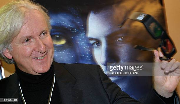 Canadian film director James Cameron poses with 3D glasses prior to a show of his movie'Avatar' on the side line of the World Economic Forum annual...