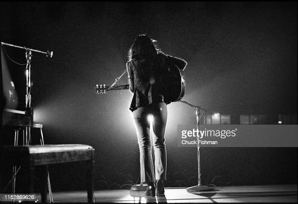 Canadian First Nations Folk musician Buffy SainteMarie plays guitar as she performs onstage during a concert at the Northern Illinois University...