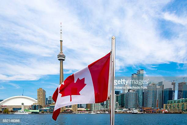 Canadian flag and the Toronto skyline The flags waves from the back of a tourist cruise in Lake Ontario