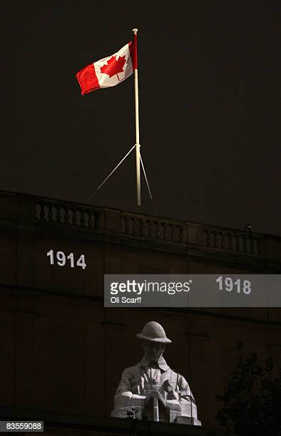 Canadian flag flies above an image of a solider projected on to Canada House in Trafalgar Square during the 'Vigil 19141918' ceremony on November 4...