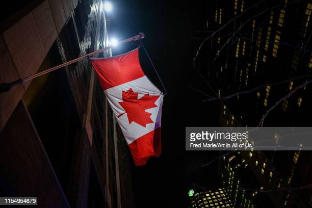 canadian flag in the city of Montreal by night Quebec Montreal Canada on January 24 2017 in Montreal Canada