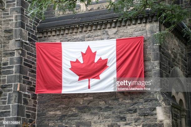 Canadian flag in University College old vintage walls The country celebrates the 150th anniversary of the confederation