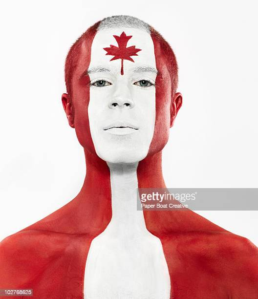 Canadian flag painted on man's face