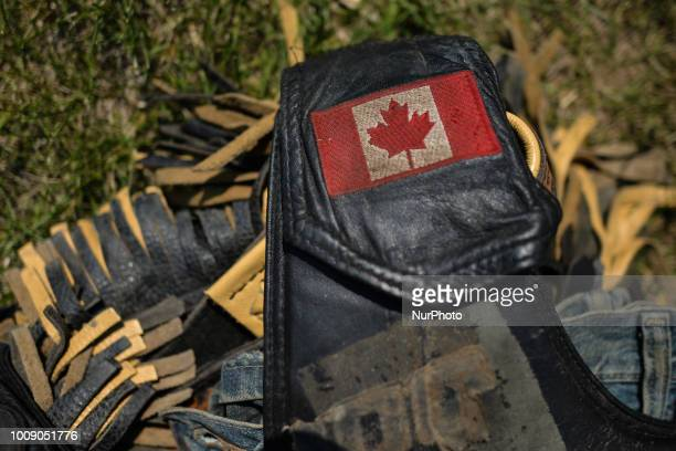 A Canadian flag seen on a cowboy's clothes during the 105th Annual Bruce Stampede the oldest one day rodeo in Canada On Sunday July 29 in Bruce...