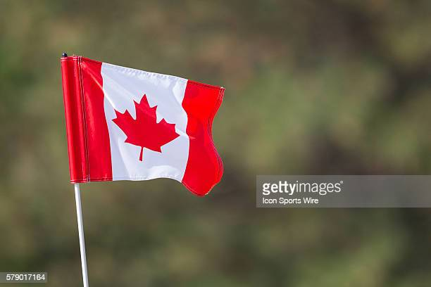 Canadian flag was at the 18th hole instead of the traditional flag during the 3rd round of the 2014 RBC Canadian Open at the Royal Montreal Golf Club...