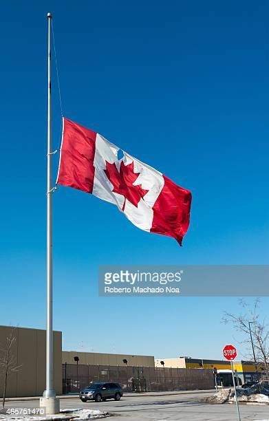 EAST TORONTO ONTARIO CANADA Canadian flag with a hole flies at half mast because of the killing of the first Canadian soldier in Iraq during the war...