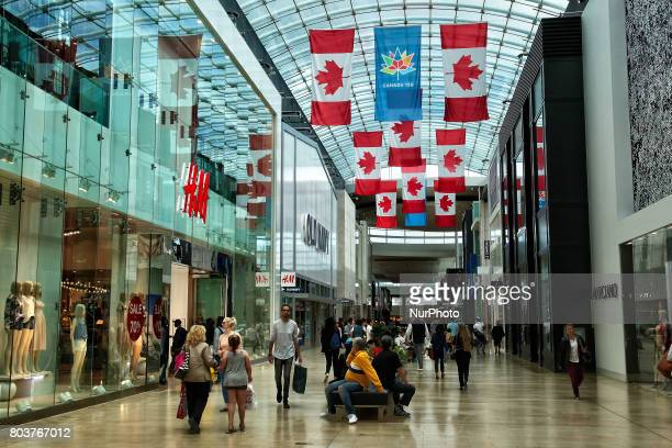 Canadian flags in a shopping mall on 30 Jiune 2017 in Toronto Ontario Canada in preparation for the upcoming celebrations for the 150th birthday of...