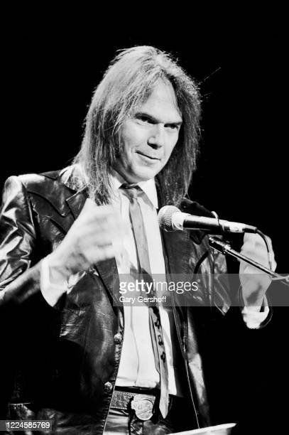 Canadian Folk and Rock musician Neil Young speaks onstage during the Third Annual Rock and Roll Hall of Fame Awards ceremony at the Waldorf Astoria...