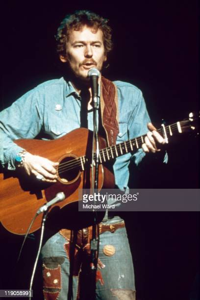 Canadian folk singer and songwriter Gordon Lightfoot performing with his guitar 1964