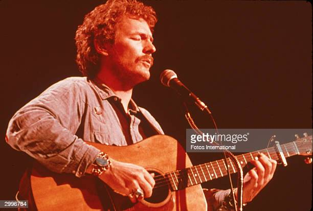 Canadian folkrock singer and songwriter Gordon Lightfoot sings and plays acoustic guitar for the television concert series 'Midnight Special' 1970s