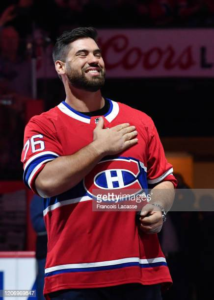 Canadian football player Laurent Duvernay-Tardif greets the fans in a ceremony prior to the NHL game between the Montreal Canadiens and the Arizona...