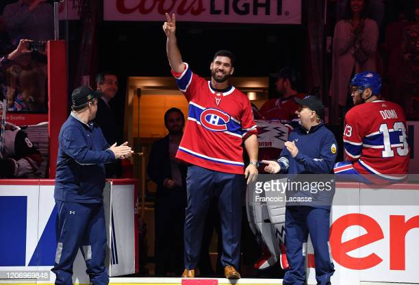Canadian football player Laurent DuvernayTardif greets the fans in a ceremony prior to the NHL game between the Montreal Canadiens and the Arizona...