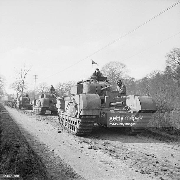 Canadian Forces In The United Kingdom 193945 Churchill tanks during Exercise 'Spartan' 9 March 1943 Leading vehicle is a Mk I with hullmounted 3inch...