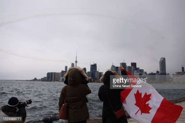 Canadian Forces Snowbirds fly over Toronto during the Operation Inspiration crosscountry tour to salute Canadians for fighting against the COVID19...