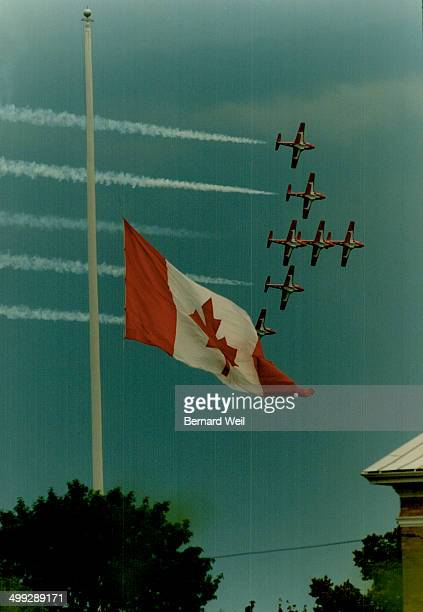 Canadian Forces Snowbirds perform with CNE flag at half - most to honour Nimrod crew