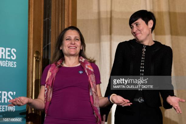 Canadian Foreign Minister Chrystia Freeland and Norwegian Foreign Minister Ine Marie Eriksen Soreide pose for pictures during the Women Foreign...