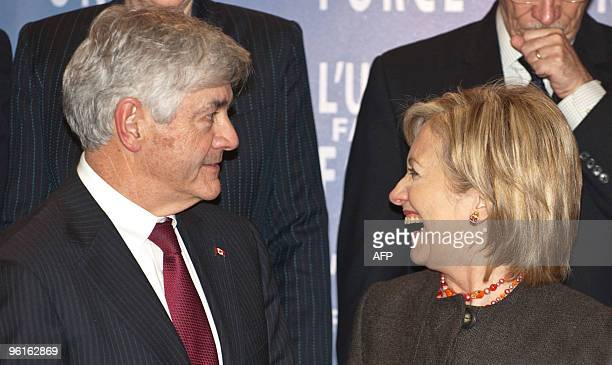 Canadian Foreign Minister Lawrence Cannon and US Secretary of State Hillary Clinton talk during a photo opportunity at the end of the Haiti...