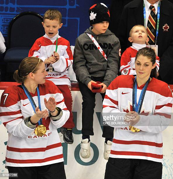 Canadian forward Cherie Piper looks over after team Canada received their gold medals during the medals ceremony in the Woman's Ice Hockey games at...