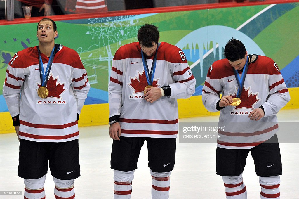 Canadian forward Ryan Getzlaf (51) wear their gold medals during the medals ceremony in the Men's Gold Medal Hockey match against the USA at the Canada Hockey Place during the XXI Winter Olympic Games in Vancouver, Canada on February 28, 2010. Canada beat the USA 3-2 to win gold.