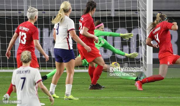 Canadian goal keeper Stephanie Labbe can't get to a ball struck by midfielder Rose Lavelle of the US national team during the second half of their...