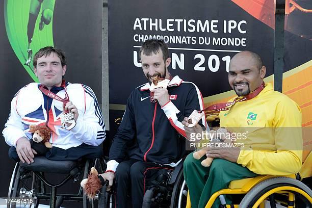 Canadian gold medalist Brent Lakatos Great Britain's silver medalist Mickey Bushell and Brazilian bronze medal Ariosvaldo Silva pose on the podium of...