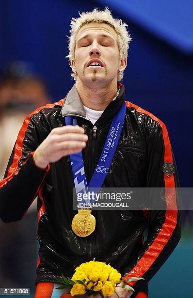 Canadian gold medalist Marc Gagnon is overcome by emotion on the podium of the men's 500m short track speed skating event at the Ice Center 23...