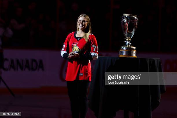Canadian Golfer Brooke Henderson stands in the spotlight before National Hockey League action between the Washington Capitals and Ottawa Senators on...