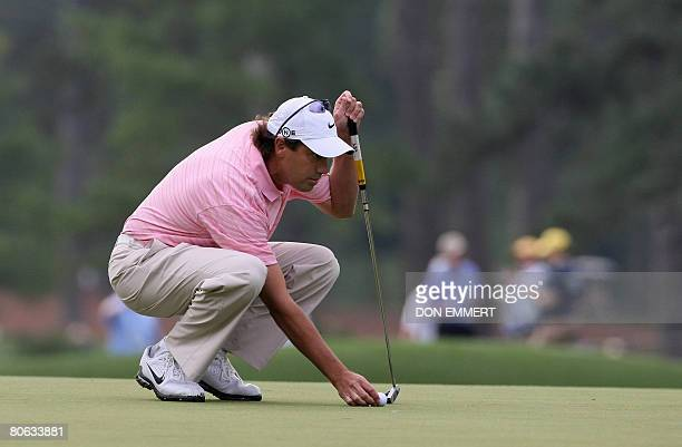 Canadian golfer Stephen Ames sets up his putt on te third green during the second round of the US Masters at the Augusta National Golf Club on April...