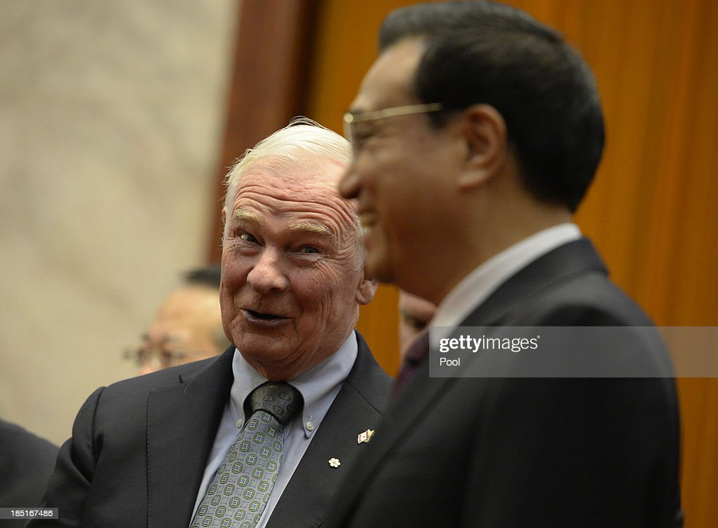 Canadian Governor General David Johnston (L) talks to Chinese Premier Li Keqiang (R) before a meeting at the Great Hall of the People on October 18, 2013 in Beijing, China. David Johnston is visiting China focusing on Canada-Sino relations and is expected to speak at the Canada China Business Council's annual meeting.