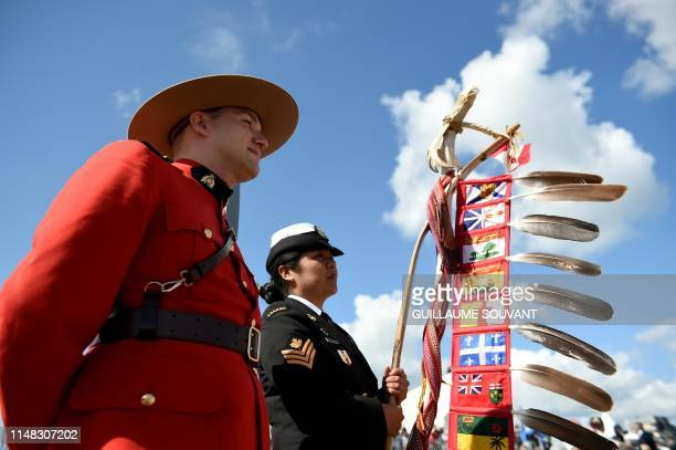 Canadian Guard stands prior the international ceremony on Juno Beach in Courseulles-sur-Mer, Normandy, northwestern France, on June 6 as part of...