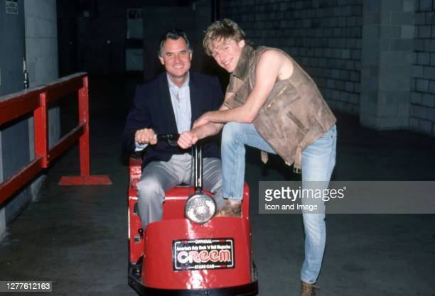 Canadian guitarist, singer, composer, record producer, photographer, philanthropist, and activist Bryan Adams an an unidentified man backstage at the...