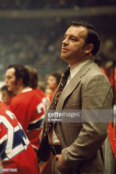 4770936b338 Canadian hockey coach Scotty Bowman of the Montreal Canadiens dressed in a  suit watches the action. Detroit Red Wings