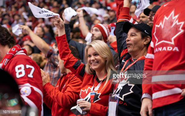 Canadian hockey fans celebrate Team Canada's 140 win over Denmark in Group A hockey action of the 2019 IIHF World Junior Championship action on...
