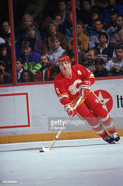 Canadian hockey player Al MacInnis of the Calgary Flames skates with the puck during a game early 1990s