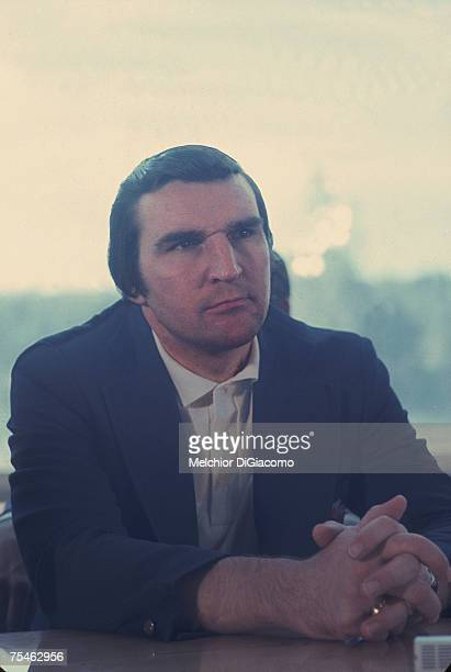 Canadian hockey player and Team Canada General Manager John Ferguson sits at a table and listens with his hands clasped during the Summit Series...