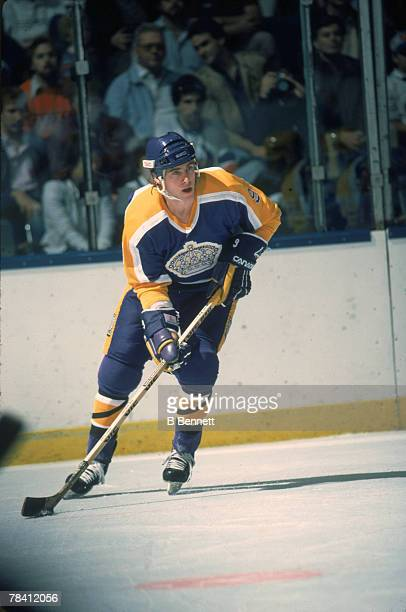 Canadian hockey player Bernie Nicholls of the Los Angeles Kings skates with the puck on the ice during a game October 1984