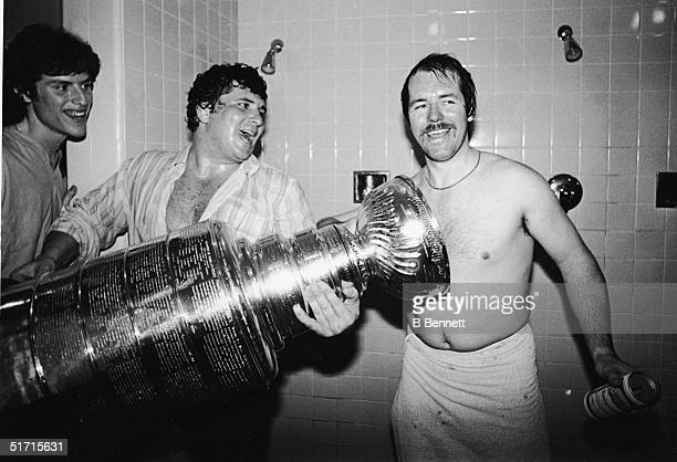 Canadian hockey player Billy Smith goaltender for the New York Islanders celebrates with the Stanley Cup in the shower after the Islanders defeated...