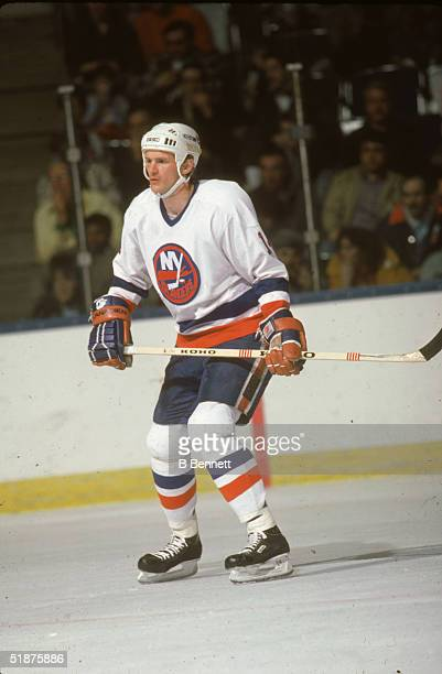 Canadian hockey player Bob Bourne of the New York Islanders keeps an eye on the action during a home game at Nassau Coliseum Uniondale New York April...