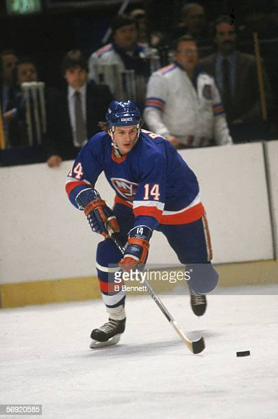 Canadian hockey player Bob Bourne of the New York Islanders skates with teh puck during a game at Madison Square Garden New York New York 1980s