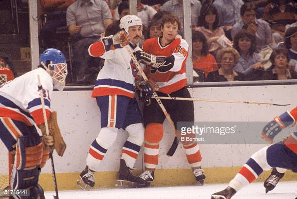 Canadian hockey player Bobby Clarke captain of the Philadelphia Flyers and Canadian hockey player Bryan Trottier center for the New York Islanders...