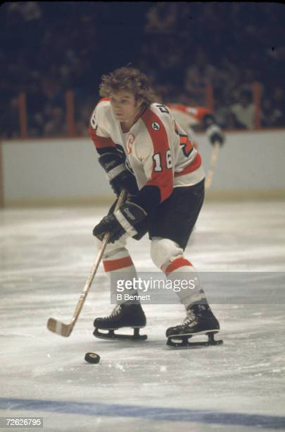 a9074567d6e Canadian hockey player Bobby Clarke of the Philadelphia Flyers skates with  the puck during a game