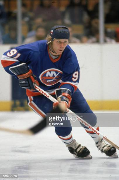Canadian hockey player Butch Goring of the New York Islanders skates on the ice, early 1980s.
